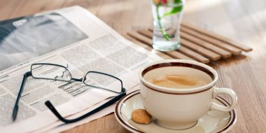 Still-life-wooden-table-glasses-newspaper-coffee_1680x1050.jpg